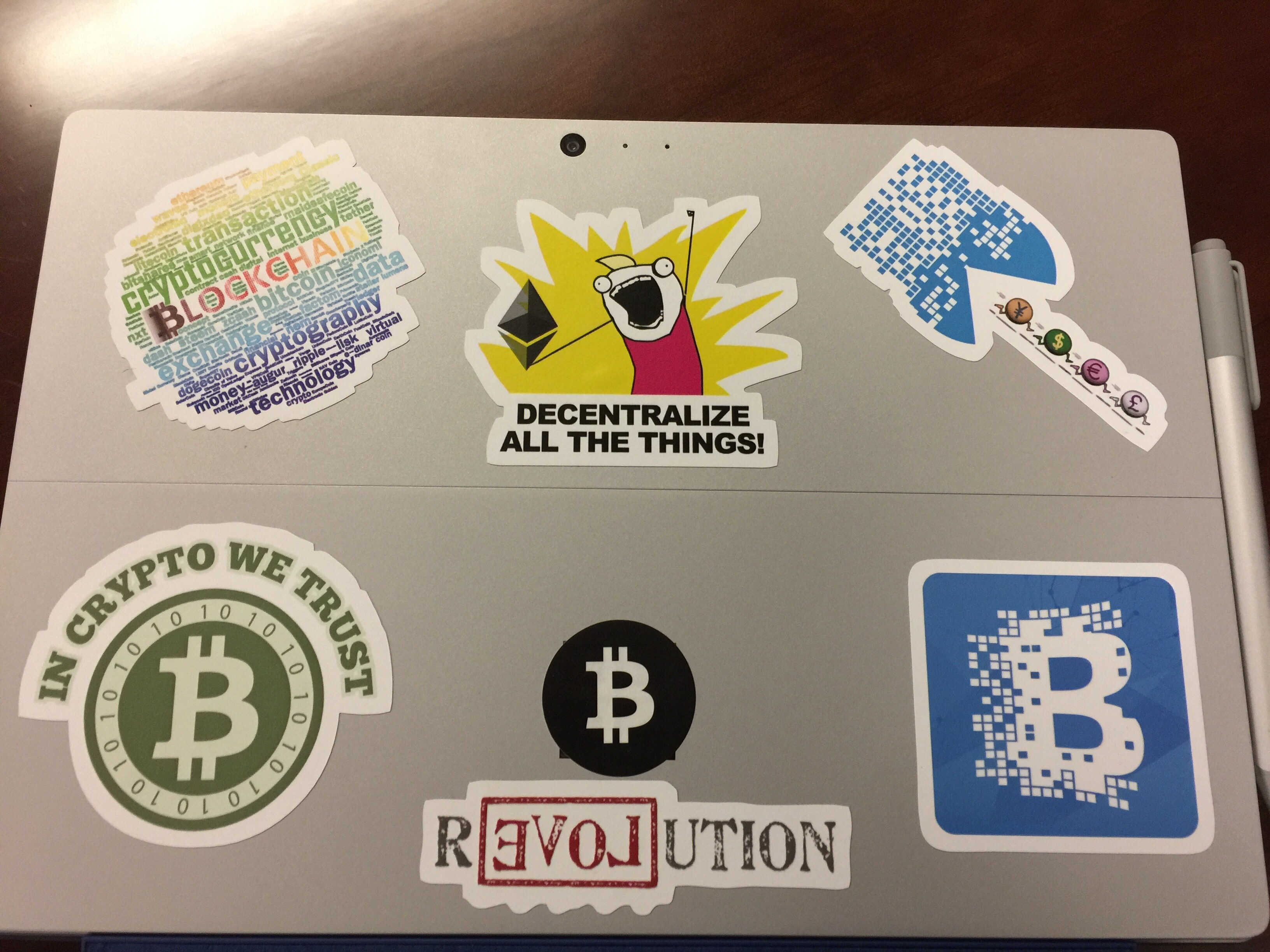 Cryptocurrency and blockchain stickers on a laptop