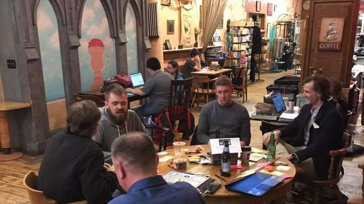 Some of the attendees from the Des Moines Bitcoin & Blockchain group enjoying an icebreaker activity during a meetup